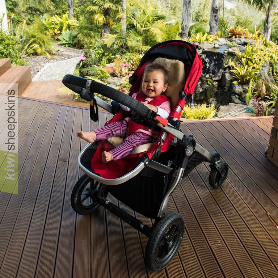Auskin pram liner fitted in buggy with baby