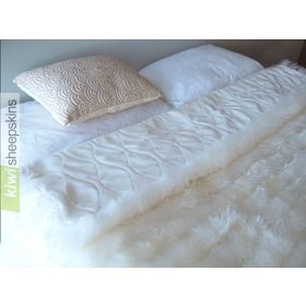 Bowron lambskin minx throw on bed
