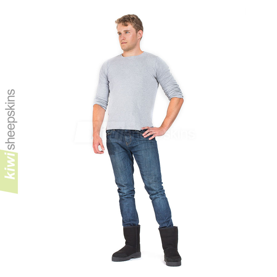 Man wearing Mid Calf Ultimate boots in Black color
