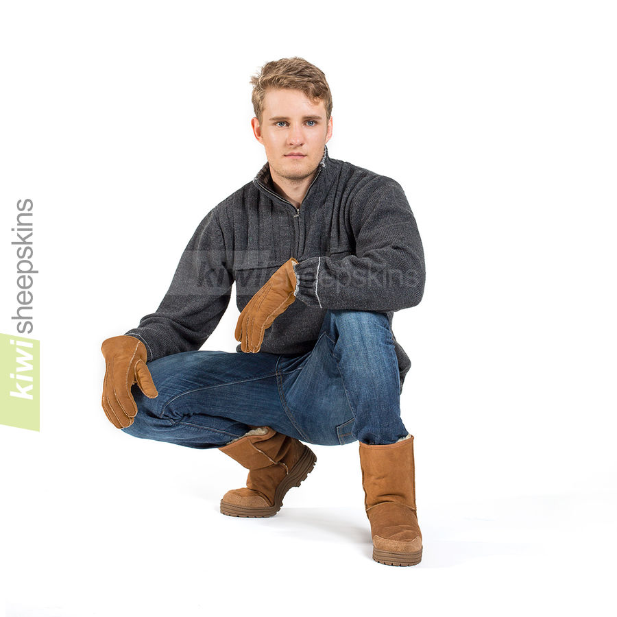Man wearing Mid Calf Ultimate boots in Chestnut color
