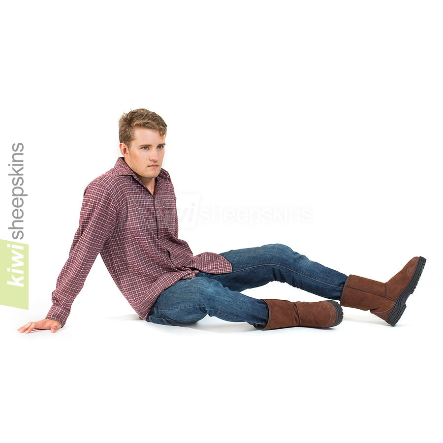 Man wearing Mid Calf Ultimate boots in Chocolate color