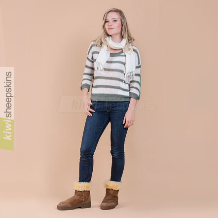 Woman wearing Mid Calf Ultimate boots in Chestnut color