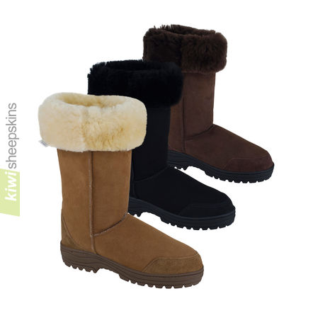 Tall sheepskin boots with tops folded down