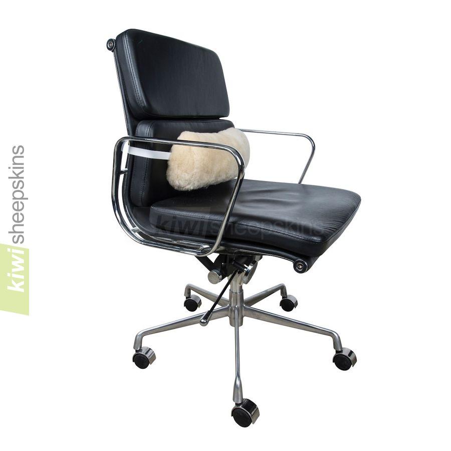 Sheepskin lumbar roll on chair