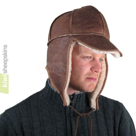 Sheepskin trapper hat man - flaps down, peak down