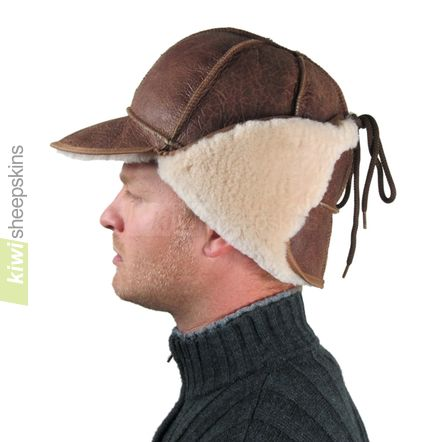 Sheepskin trapper hat man - flaps up, peak down - side view