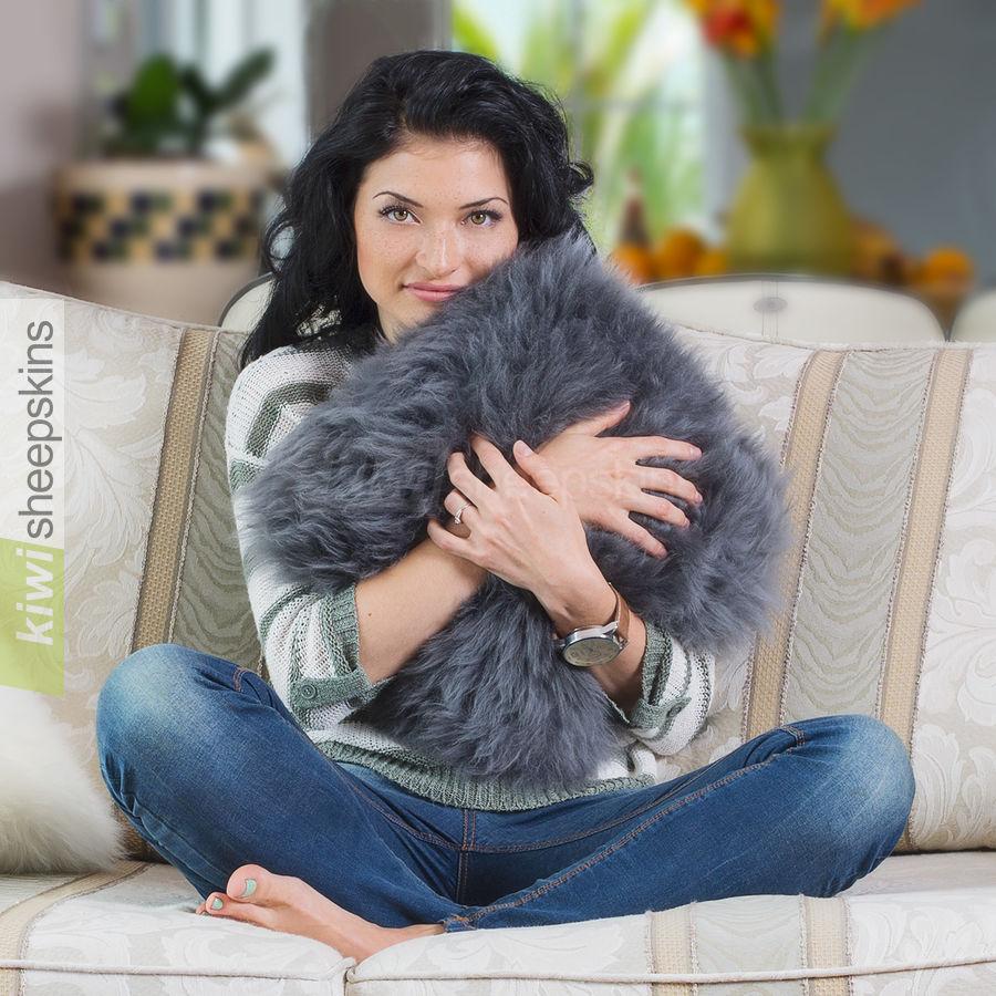 Grey sheepskin pillow modelled