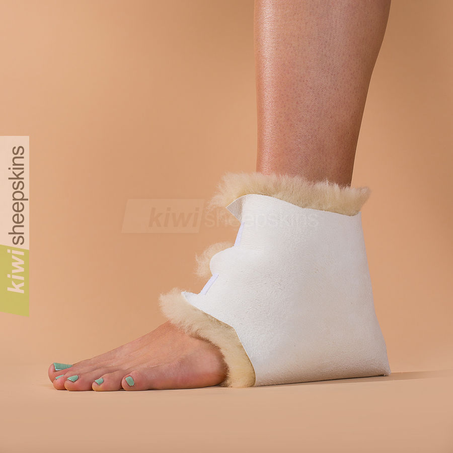 Medical sheepskin heel/elbow pad modelled on heel