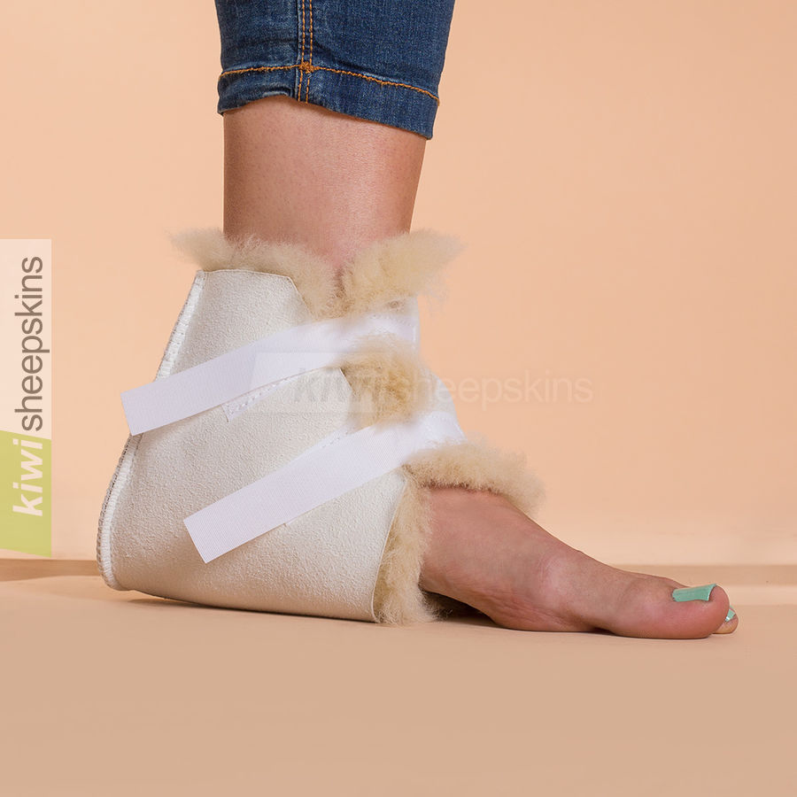 Medical sheepskin heel/elbow pad showing fastening straps