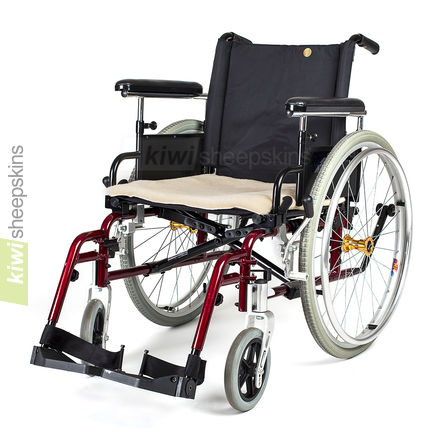 Sheepskin wheelchair seat pad shown on manual wheelchair