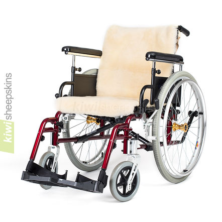 Sheepskin wheelchair cover on manual wheelchair