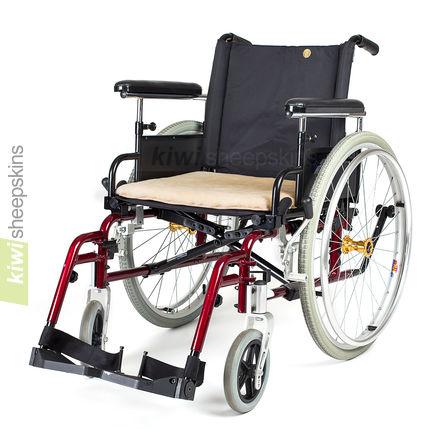 Padded sheepskin seat pad on wheelchair