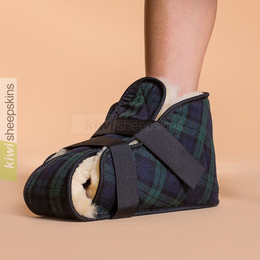 Open sheepskin medical boot shown fitted to foot